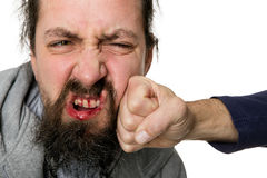 Man beeing slapped with a fist. Bloody man beeing slapped with a fist Stock Images