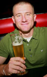 Man with Beer. A sexy man smiling holding a beer Stock Image
