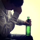 Man with a Beer Bottle Stock Images