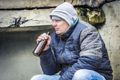 Man with beer bottle under the bridge Royalty Free Stock Photos