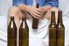 Man with beer bottles. Alcohol abuse and loneliness Stock Photos