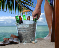 Man With Beer Bucket at the Beach Stock Image
