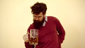 Man with beer. Emotional funny bearded drunk hipster holds craft bottled beer. Man with beard drunk beer. Man with beer. Emotional funny bearded drunk hipster stock footage