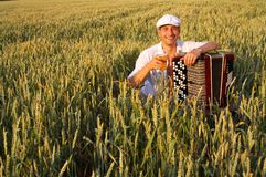Man with beer in field Royalty Free Stock Photos