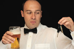 Man with beer and keys royalty free stock photos