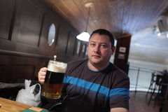 Man with beer in a pub Royalty Free Stock Images