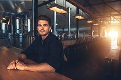 Man at beer tasting room Stock Image