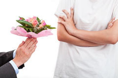Man begging with flowers Stock Photo