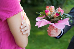 Man begging for forgiveness. Man with flowers begging for forgiveness his woman stock photography
