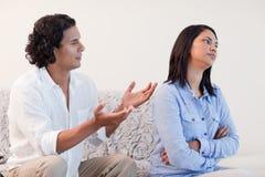 Man begging his girlfriend for pardon Royalty Free Stock Image