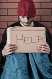 Man begging on the street with help sign Royalty Free Stock Image