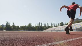 Man beginning his race with low start and running to meet victory, goal of life stock footage