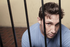 Man behind bars Royalty Free Stock Photo