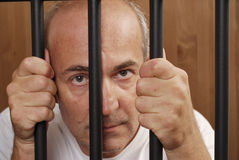 Man Behind Bars royalty free stock photography