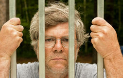 Man behind bars Stock Image