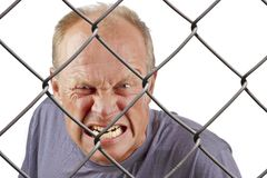 Man behind bars Stock Photography
