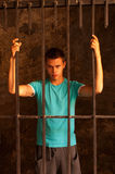 Man behind the bars Royalty Free Stock Images