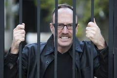 Man behind bars Stock Image