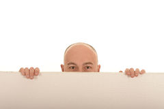 Man behind board Royalty Free Stock Image