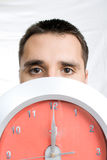 Man Behind Clock. Man looking out from behind a clock Stock Images