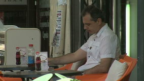 The man behind the coffee shop in Varna. Bulgaria. Varna - the sea capital of Bulgaria, a center of shipping and tourism. Today it is the third largest and most stock video footage