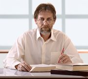 Man behind a desk Stock Photo