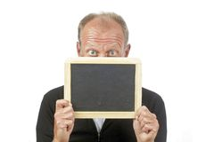 Man behind an empty blackboard Stock Photo