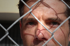 Man Behind A Fence Royalty Free Stock Photos