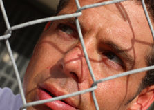 Man Behind A Fence Royalty Free Stock Images
