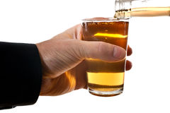 Man behind glass of brandy Stock Images