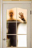 Man behind the Glass Door Royalty Free Stock Photo