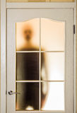 Man behind the Glass Door Royalty Free Stock Photos