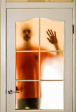 Man behind the Glass Door Stock Photography