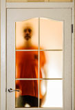 Man behind the Glass Door Royalty Free Stock Image