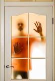 Man behind the Glass Door Stock Photos