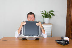 Man behind his computer Stock Images