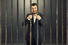 Man behind the prison cell Royalty Free Stock Photos
