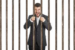 Man behind the prison cell over white Royalty Free Stock Photos
