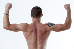 Man from behind raising up his arms Stock Photos