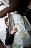 Man Behind Russian Map Stock Images