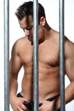 Man behind steel Prison Bars Royalty Free Stock Photography