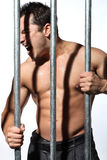 Man behind steel Prison Bars Royalty Free Stock Image