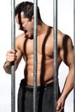 Man behind steel Prison Bars Stock Photos