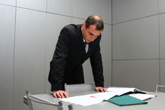 The man behind a table with documents Royalty Free Stock Photo