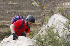 Man behind a tree in a via ferrata. In Spain Royalty Free Stock Images