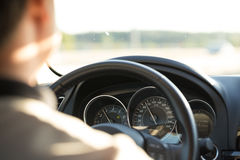 Man behind the wheel in the evening. Stock Photography
