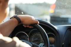 Man behind the wheel in the evening. Royalty Free Stock Images