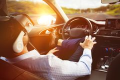 Man behind the wheel wearing a virtual reality helmet royalty free stock photos