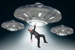 Man being abducted by UFO - alien abduction concept Royalty Free Stock Images