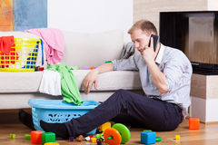 Man being alone at home with child Stock Photography